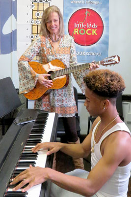 Susan Darrow on guitar with student on piano
