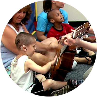 children with special needs enjoying music class